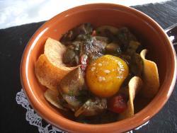 Cassolette di funghi porcini con chips di patate e tuorlo d'uovo