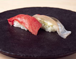 From the hands of the master two nigiri-zushi-toro (choice tuna belly) and horse